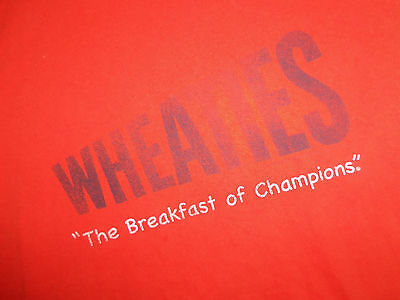 "Primary image for Wheaties Brand Cereal ""The Breakfast Of Champions"" Orange Graphic T Shirt - M"