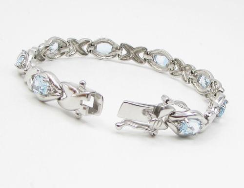 925 Sterling Silver - Blue & White Topaz XO Tennis Bracelet - B1393