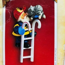 Santa to the Rescue 2004 Hallmark Christmas ornament Firefighter with cat - $12.50