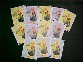 12 handmade cards w/envelopes;Little girl w/egg full of blue flowers - $25.00