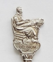 Collector Souvenir Spoon Belgium Lace Maker Figural Coat of Arms Repouss... - $14.99