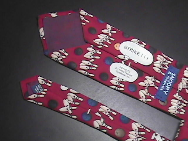 Peanuts Snoopy and Friends Silk Neck Tie Titled Strike!!! Darker Red Background