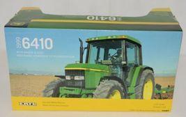 John Deere TBE15489 Die Cast Metal Replica 1999 6410 Tractor Wagon Disk image 6
