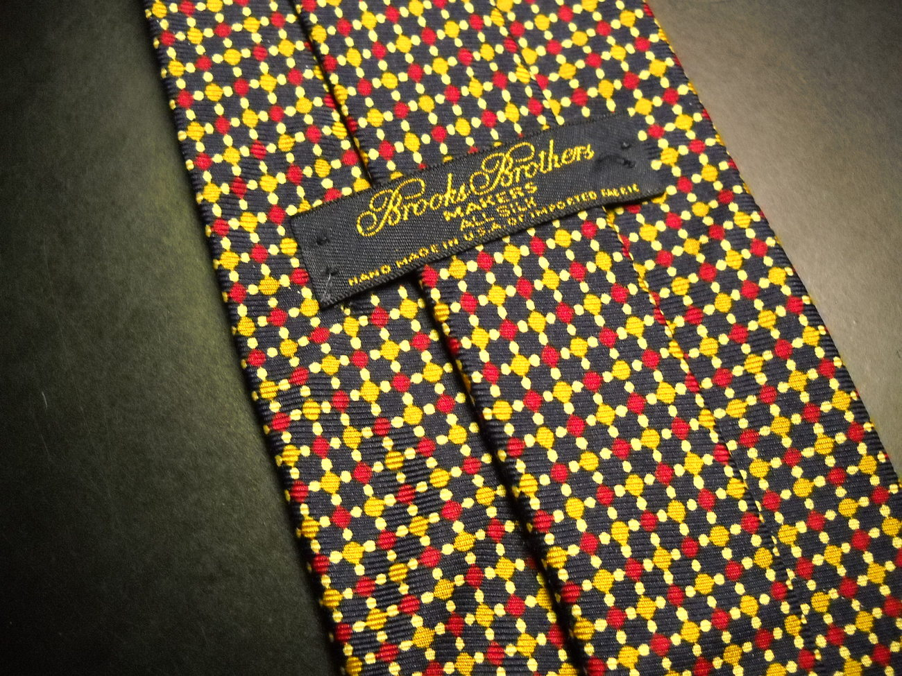 Brooks Brothers Makers Neck Tie Dark Blue Background with Gold and Red Accents