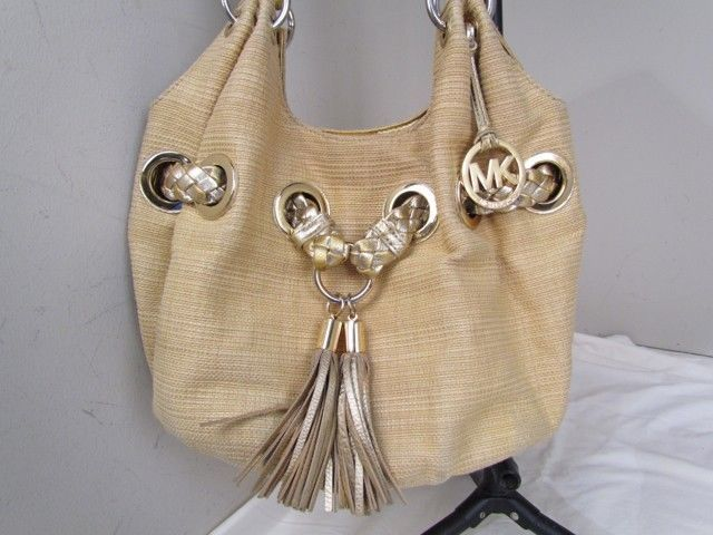 3046fa96d1556 Michael Kors Gorgeous Gold Hobo With Cross and 50 similar items