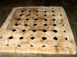 Light brown alpaca fur carpet with black rhombus designs, 150 x 110 cm - $303.80