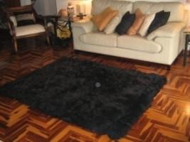 Black alpaca fur carpet, from the Andean of Peru, 150 x 110 cm - $303.80
