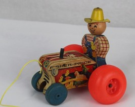 Vintage Fisher Price wooden tractor with farmer pull toy made in USA 1962 - $12.11