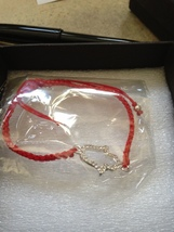 CRYSTAL METALIC BASE METAL BRACELET WITH A RED BAN - $19.99