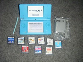 Nintendo DSi SKY Blue Handheld System Console lot of 9 Games - $53.71
