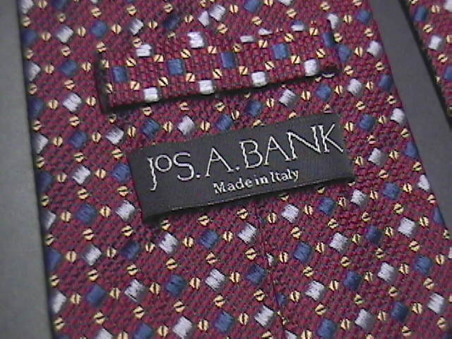 Jos A Bank Neck Tie Made in Italy Silk Brownish Maroon with Golds Silvers Blues