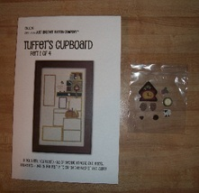 Release 2 tuffets cupboard 1 with button pack thumb200