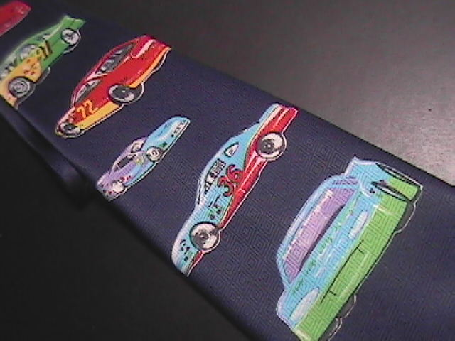 A Rogers Neck Tie Race Cars II Blue Background Cars in Greens Reds Yellows 1997