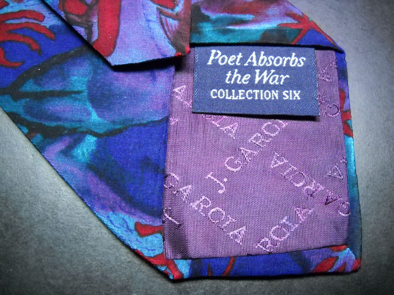 J Garcia Neck Tie Collection 06 Poet Absorbs The War Stonehenge Blues Reds Green