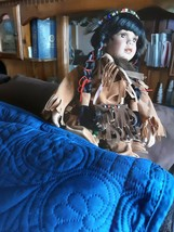 Native american porcelain child dress in  a native american suede outfit... - $29.99