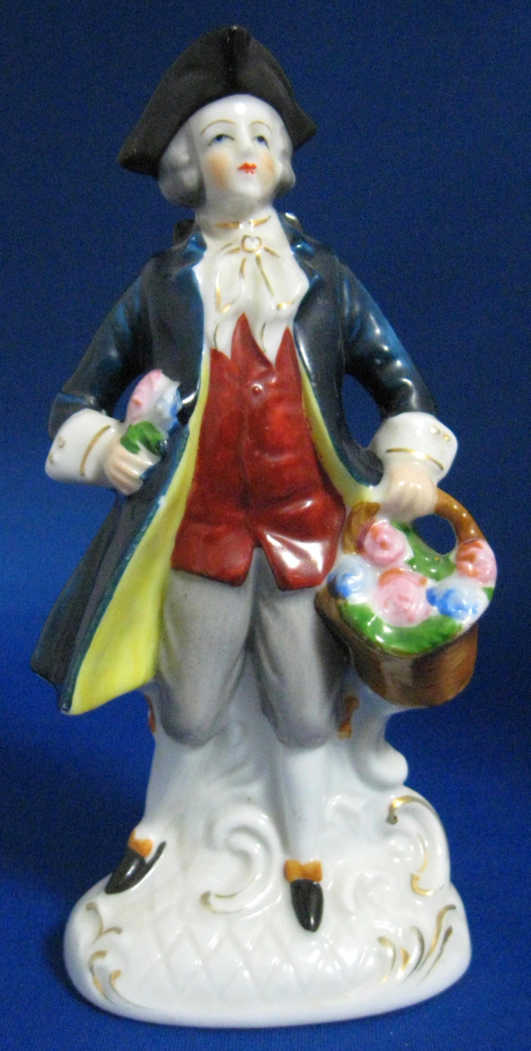 Handpainted Japan Colonial Man Carrying a Bouquet of Flowers