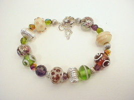 Bracelet with Lampworked and Large Hole Beads in Purple, Green and Silve... - $30.00