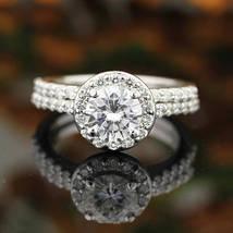 1.70 ctw 14K White Gold Over .925 Silver D/VVS1 Diamond Engagement Halo Ring Set - $114.39