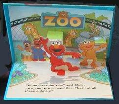 Sesame Street Pop-up Book - Elmo Goes to the Zoo [Hardcover] Lee Howard