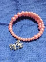 Pink beaded heart charm bracelet - $7.00