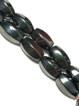 "MAGNETIC HEMATITE STONE  BEADS TWIST OVAL 8X12MM 15.5"" BEAD STRAND image 1"