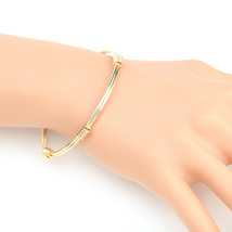 UE- Stylish Gold Tone Designer Bangle Bracelet With Contemporary Design - $13.99
