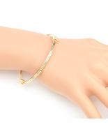 UE- Stylish Gold Tone Designer Bangle Bracelet With Contemporary Design - $14.99