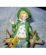 Occupied Japan Porcelain Figurine-Colonial Man in Green Jack - $45.00