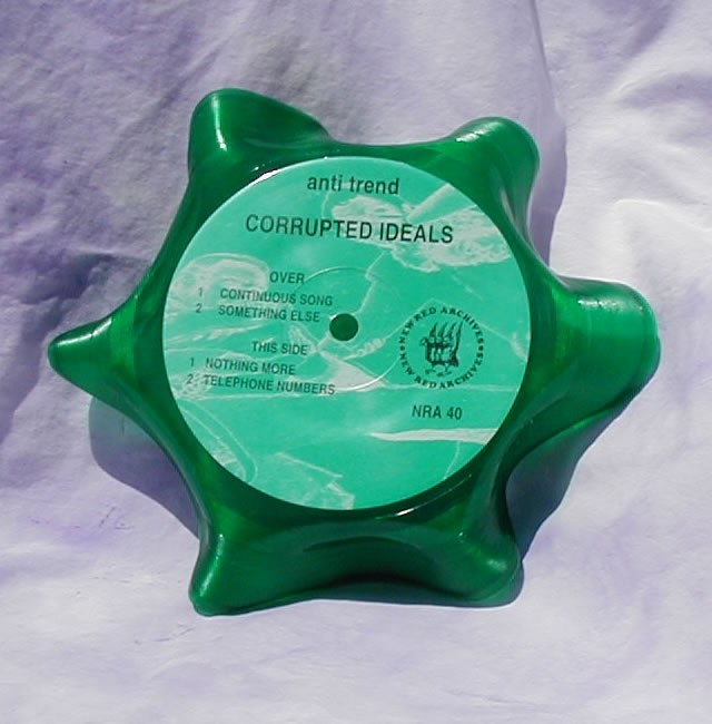"""Record bowl made with a 7"""" Green colored vinyl record"""