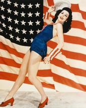 Ann Miller posing with U.S. American Flag Leggy 16x20 Poster - $19.99