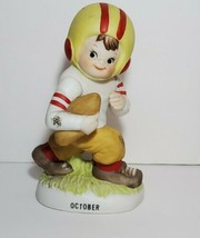 Hand Painted Lefton October Boy Figurine running with football  - $18.69