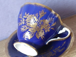 Vintage 1960's Paragon England blue and gold roses Bone china tea cup teacup - $78.21