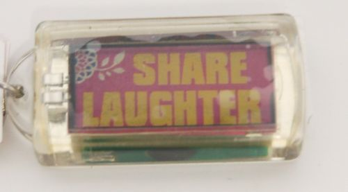 Ganz Solar Powered Flashing Share Laughter Key Chain Flowers