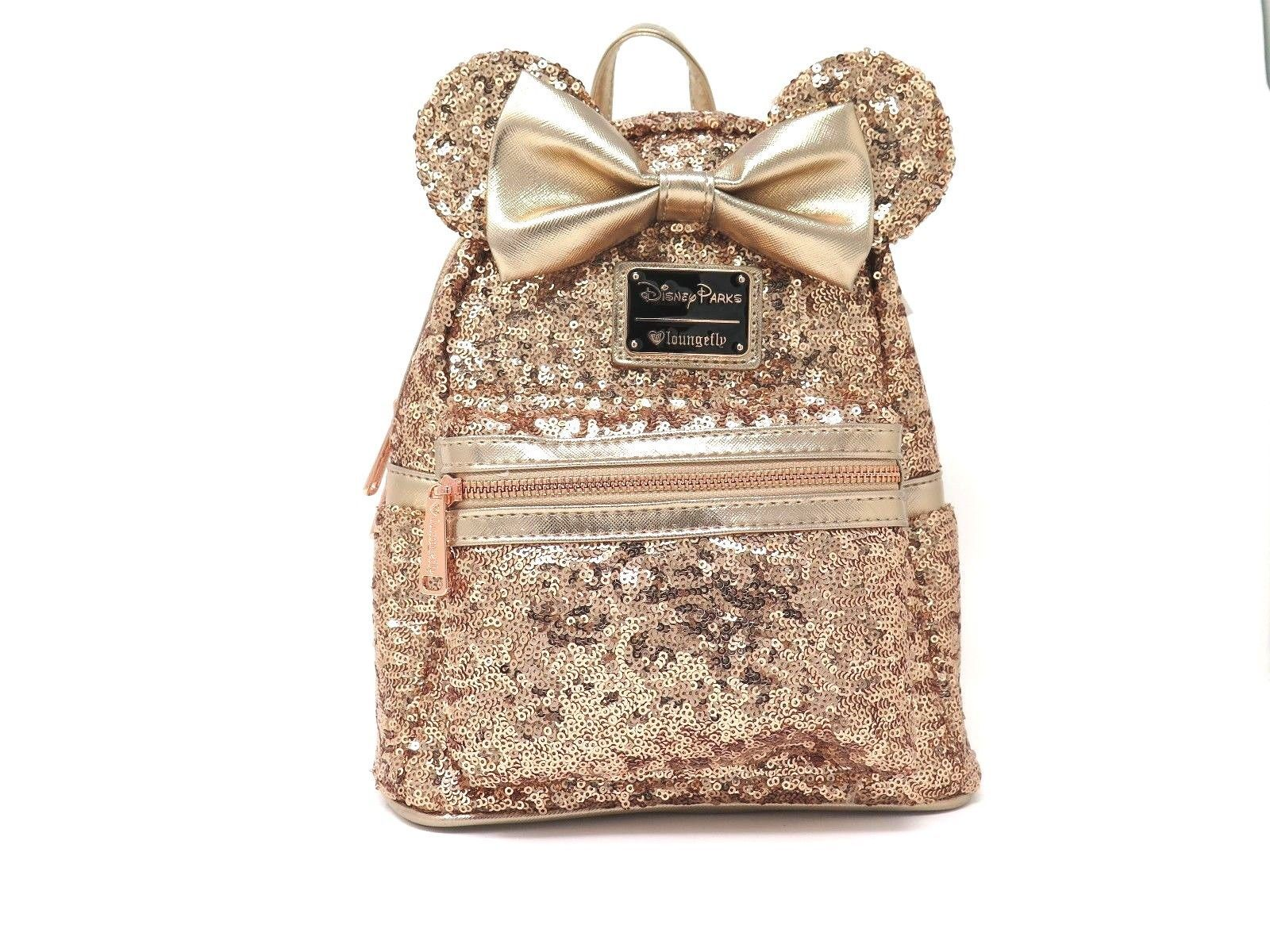 25c0ad8787 57. 57. Previous. Disney Parks Loungefly Rose Gold Sequin Minnie Mini  Backpack Purse Bag WDW Bow