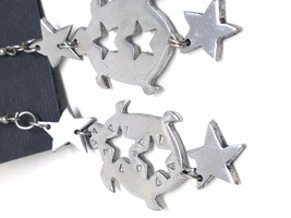 Turtles with cut out Stars Silver Tone Figural Fish Hook Earrings Vintage - $14.39