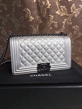 AUTH CHANEL LIMITED EDITION METALLIC SILVER PERFORATED LAMBSKIN MEDIUM BOY BAG  image 9