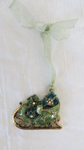 Christmas Gold Tone Metal Sleigh with Green Ornament - $5.89