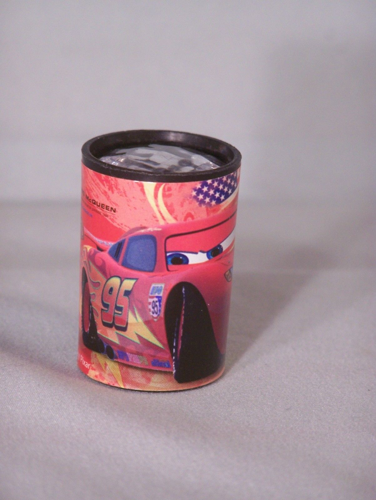 "Disney Pixar Lightning McQueen view distortion toy, approx 1.2"" long"