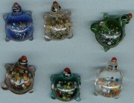 SIX GLASS TURTLE BEADS