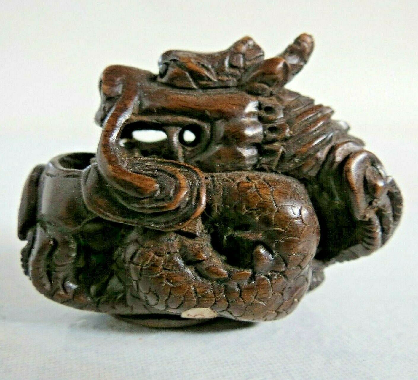 19th-20th century Japanese boxwood Netsuke Seated dragon Signed unknown onyx eye