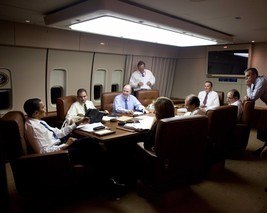 President Barack Obama meets with staff aboard Air Force One Photo Print - $6.74