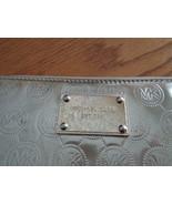 Michael Kors Clutch Wallet Bag Silver Metallic With Logo Plate - $49.97