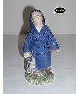 Royal Copenhagen Boy With Umbrella Figurine No. 3556 - $124.95
