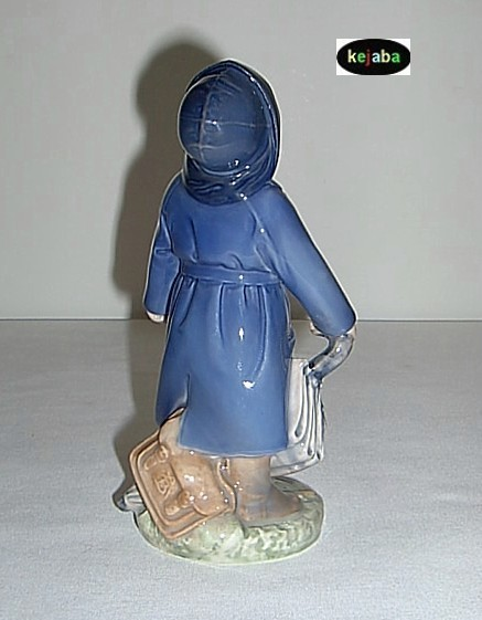 Royal Copenhagen Boy With Umbrella Figurine No. 3556