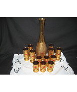 Antique gold decanter set with 12 glasses and pretty red sto - $250.00