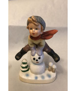 """Vintage Figurine  6"""" Tall Boy Jumping Over Snowman. Stamped 8837 - $9.90"""