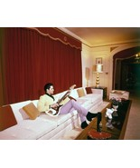 Elvis Presley - Elvis In a photo taken in the living room at Graceland ,... - $7.18