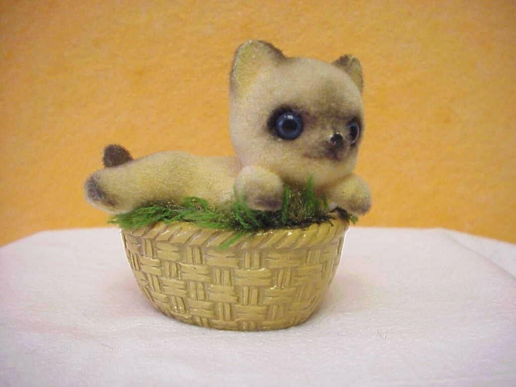 Josef Original Fuzzy Kitten on Basket - $22.00