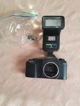 Canon T50 35mm SLR Camera body +Rokinon Flash For Parts broken - $14.01