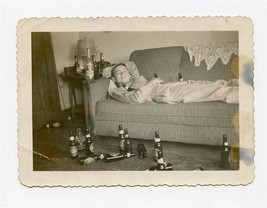 Army PFC on Sofa Amidst Many Empty Whiskey and Beer Bottles Black White ... - $27.72